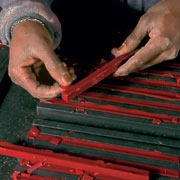 The sticks are still warm when they are removed from the molds.